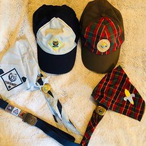 A bundle of Cub Scouts gear. 2 caps,2 scarves,belt